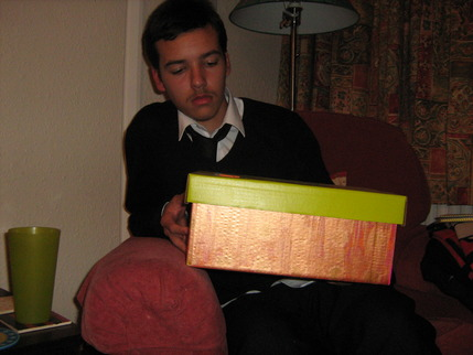 Photo of young person with box of resources